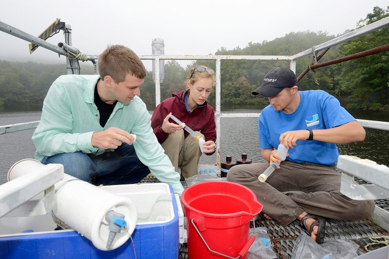 researcher and students in boat